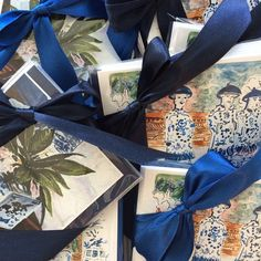Blue satin ribbons on notes by pve design