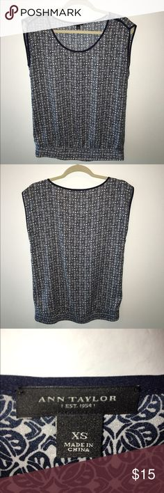 Ann Taylor Top Navy and white sleeveless top with navy detail. Slightly fitted at hips for a blouse effect. Comes from a smoke and pet free home. EUC! Ann Taylor Tops Blouses