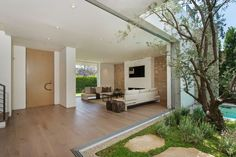 house-with-multilevel-decks-surrounded-by-gardens-23-living-room-garden.jpg