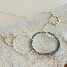 Linked Circle Necklace in Gold, Oxidized and Polished Sterling Silver designed by Lila Clare