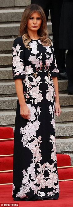 Melania Trump donned a stunning Chinese-inspired gown as she met with President Xi Jinping...