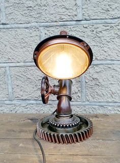 Table lamp Navigator of the frigate vendor code 01-53  Height: 42 cm (1ft 4.54in) Weight: 10 kg (22lb 0.740oz). Frame diameter: 21 cm (8.27in). LED 4w power-saving bulb. Wire length: 90 cm (2ft 3.56in). Switch: on the wire, at a distance of 15-30 cm (5.91 - 11.8in) from the lamp. Switch is put on the wire, at the customers order at any distance from the lamp. A light bulb is not included in the kit. The product is ready for use and meets all electrical standards. Materials: cast iron, steel…