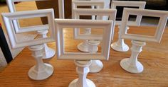 DIY Table Signs. Small frames mounted on short candlesticks, all painted white. | Craft Fair/Farmer's Market ideas | Pinterest | Diy Table, Candlesticks and Fr…