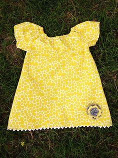 Infant peasant dress with crochet flower embellishment