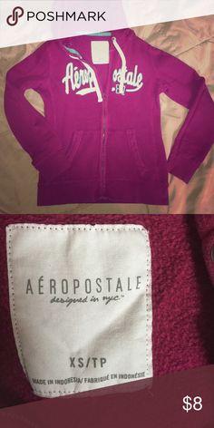Aeropostale sweatshirt. Purple/pink Aeropostale thick sweatshirt. Purple/Pink color with a teal outlining the white lettering. Lightly worn. Great condition. Aeropostale Tops Sweatshirts & Hoodies