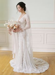 Stunning, romantic, vintage inspired wedding dress by Melissa Sweet from David's Bridal! Photography Laura Gordon | Flowers + Design Studio Mondine | Styling Emily Newman and Ashley Meaders for Once Wed | Hair + Makeup Angela Nunnink #DavidsBridal #MelissaSweet #DBMaids