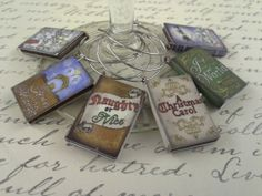 $19.99 'Tis the season for wine charms. Keep your glasses merry and bright with these Christmas Carol wine glass charms.