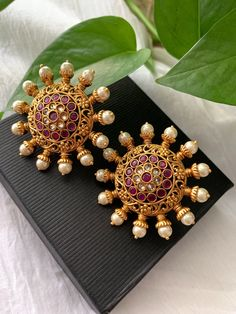 Suryakanti Circle ruby and white stones Stud Earrings/ Statement Jhumka Earring/Bollywood/ Gold finished stud earrings Indian Jewelry Earrings, Gold Jhumka Earrings, Jewelry Design Earrings, Gold Earrings Designs, Emerald Earrings, Stud Earrings, Antique Earrings, Gold Bangles Design, Gold Jewellery Design