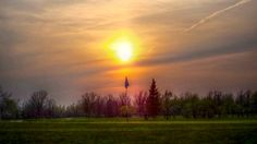 Smoky Sunset over the Flag at Oakwood Golf Course along the Dawson Trail in Manitoba