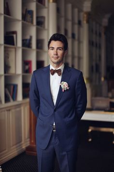 Navy blue with bow tie handsome groom look. Groom Attire: Albione http://www.weddingchicks.com/2014/05/14/glamorous-russian-wedding-you-have-to-see-to-believe/