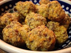 THM Sausage Balls Mix together 2 c almond flour with 3 tsp baking powder and I tsp salt. Add in 1 TB melted butter and 1 egg. Stir in 8 oz grated sharp cheddar cheese and 1 lb sausage. Roll into balls. Bake 20-25 mins @ 375 on a parchment lined baking sheet.