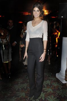Bianca Brandolini D'Adda in a sheer ivory blouse + black high-waisted trousers + black heels