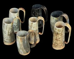 """Horn Beer Mugs from The Jelling Dragon  """" As seen on GAME OF THRONES!  Our horn beer mugs are hand made in England from a single piece of cow horn which is cut out to shape, heated and then shaped to form a handle. A wooden base is then added using a food-safe resin. Suitable for all cold drinks. Every one is unique!"""""""