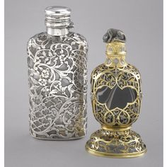 TWO GERMAN SILVER-MOUNTED SCENT BOTTLES, BOTH CIRCA 1900 a silver-mounted glass scent bottle with hinged lid, stamped Schürmann; a probably German silver-mounted agate scent bottle, cap missing, agate in foot missing, apparently unmarked