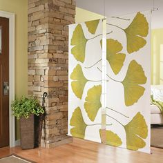 In a small home or studio apartment there isn't always enough room for a solid room divider, but here's how to make a fabric room divider that can be hung from the ceiling.