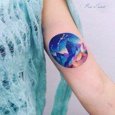 Stunning watercolor mountain range tattoo by Pis Saro