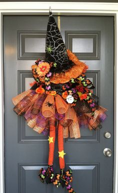 This Deco Mesh Witch will be beautiful hanging out on your front door for the Halloween holiday.  She is dressed in Halloween colors of orange black