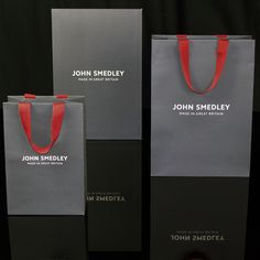 John Smedley Luxury artpaper carrier. Created as part of John Smedleys rebrand this range of packaging emulates the luxury feel of the brand perfectly. #luxurypackaging #packaging #carrierbag