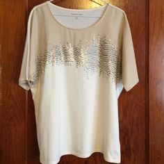 Beautiful Neutral Tee by Coldwater Creek This dolman sleeve tee is made of a cream knit with a tan chiffon overlay at the top reaching to the cream & bronze sequined accents. Size M. Worn once. Excellent condition. Coldwater Creek Tops Tees - Short Sleeve