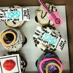 Taylor Swift 1989 concert cupcakes. Neon bracelets, fondant concert ticket, Polaroid, and a pink guitar.