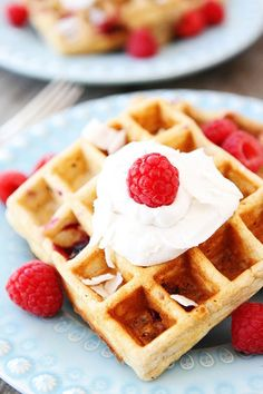 Turn breakfast waffles into a tropical treasure with coconut whipped cream and raspberries! Directions: Scoop the top thick layer from a can of cold, white coconut milk into the bowl of a mixer. With the whisk attachment, beat on high speed until the mixture turns to liquid, about 20 secs. Add in 1tbsp powdered sugar and 1/2tsp vanilla extract, mix on high for 1-2 minutes, until creamy. Add whipped cream and raspberries to waffles and enjoy!  For added pleasure top with shredded coconut!!!
