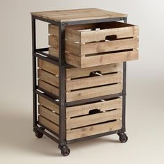 Add some rustic charm to your home office with our handsome three-drawer cart. Featuring crate-inspired slat wood drawers, a distressed metal frame and swiveling, locking wheels, it brings warm, casual style to functional storage.