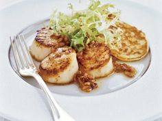 Stewart Woodman often serves savory waffles and pancakes with his dinners in place of rice or potatoes. Here, he pairs big, beautifully seared scallop......