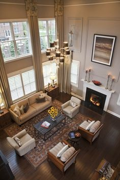 Two story living room. I'd go with more gray and less beige on the walls, but otherwise this is exactly what I want.