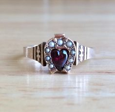 Want to be lucky in love? Try committing to a horseshoe- and heart-adorned vintage ring. #etsyjewelry