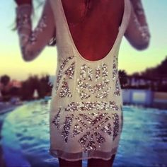 Great website!!!!!!   White Low Back Sequin Dress