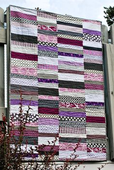 love this! purple and gray scrappy quilt | bijou lovely plus wavy quilting