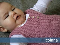 A sweet baby vest with lovely details.                              …