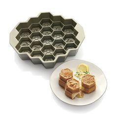 Create a buffet buzz with this unique honeycomb-shaped pan that divides baked treats into perfectly portioned cakelets. Durable cast aluminum pan heats quickly and evenly for superior baking performance, with a heat-reflective platinum exterior to ensure uniform browning. Proprietary nonstick surface allows for clean release and easy cleanup.