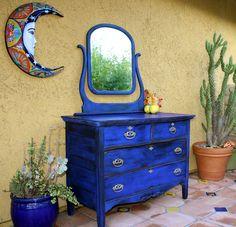 Restoring an old dresser with cobalt milk paint.