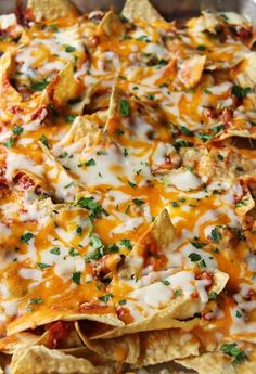 easy nachos: just add cheese and choice of toppings and bake at 350