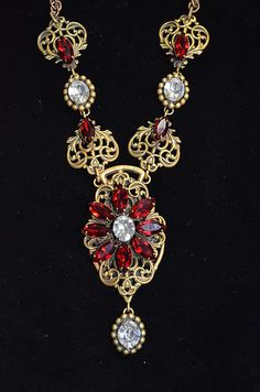 Joseff Hollywood Jewelled Filigree Flower Necklace with Ruby and Diamond like stones.