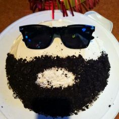 Have a bearded man in your life? Make him a bearded birthday cake with crushed Oreo cookies.