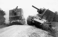 Baltic Front, A heavy Russian tank abandoned on the side of the road. A German tank destroyer Marder III is passing by