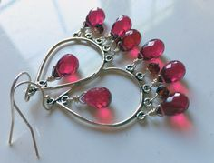 """I'll get you, my pretty... EARRINGS, that is. I used high quality sterling chandeliers and arranged gemstones including ruby red quartz and garnet rondelles. These earrings including earwire are about 2"""" in total length and an easy weight to wear. *PLEASE CHOOSE your ear wire preference.* There is a coordinating necklace sold separately. Your earrings will arrive beautifully giftboxed."""