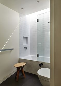 The geometry of the addition lets a soft, natural light wash over the new bathroom.
