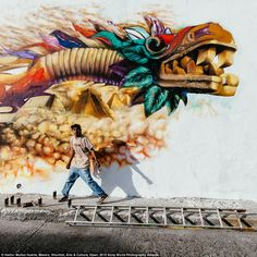 The old and the new: A Mexican grafitti artist works on a Quetzalcoatl, the benign pre-Hispanic God that gave corn and fire to men