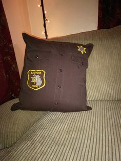 Just send a uniform shirt and $25 and I'll make a pillow. Police