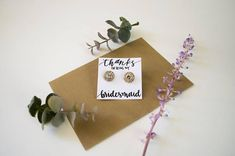 Planning on buying your bridesmaids some jewelry? Add a personalized touch with custom earring or necklace holders. Please NOTE in purchase details: 1.) white or kraft paper 2.) if personalized, a list of your lovely ladies' names followed by title (bridesmaid, maid of honor) VERY