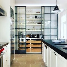 Look how fabulous these frosted glass and iron barn doors look in this Kitchen. Something as simple as this makes this Kitchen look hip, modern, industrial and just plain awesome.