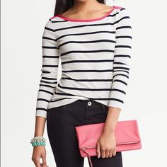 Gap creamy white, navy blue and hot pink  sweater SIZE: extra small  DETAILS:  Fitted at the end of the sleeves and bottom, sleeves button with 4 buttons (as shown). Model isn't wearing exact sweater- just to show style/fit.  Pet and smoke free home! GAP Sweaters