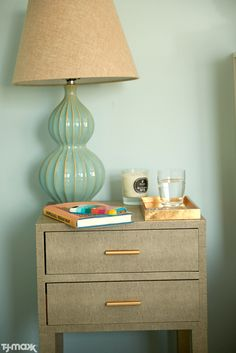 Weekend project: A nightstand refresh. We're loving this table lamp's classic shape and interesting textures. Add a scented candle and a statement-making tray to hold bedside odds and ends.