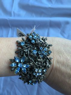 The wonderful gunmetal very adjustable cuff bracelelt is super pretty! The vintage brooch I used on it has the most wonderful ice blue rhinestone crystals on it. This bracelet is one of a kind and will never/ can never be repeated.  - $29.99