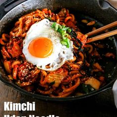 Kimchi udon noodle stir fry is an easy weeknight meal that can be ready in 15 mins. Key ingredients are bacon, Kimchi, udon noodles and Korean spicy sauce. It's simply addictive! It will be your new favourite noodle dish! | MyKoreanKitchen.com