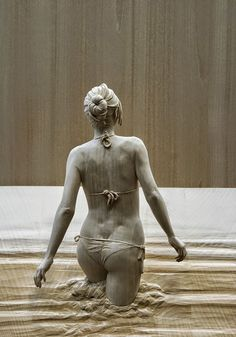 Italian artist Peter Demetz has a gift for breathing life into wood, a material that seems hard and lifeless to most of us. His wooden sculptures of people are flawlessly life-like.