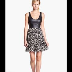 ✨HP✨ BB DAKOTA faux leather bodice dress A faux-leather, tank-style bodice combines with a deftly pleated, animal-print skirt for a twirly dress with plenty of modern attitude.  Partially lined. Bodice is polyurethane; skirt is polyester; hand wash.  Wore one time for a dinner and the dress is in excellent condition. BB Dakota Dresses